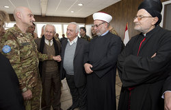 UNIFIL Head of Mission and Force Commander Major-General Luciano Portolano welcoming to the meeting Sheik Hassan Dali (centre) and Archbishop Shukrallah Nabil el Hajj (right)